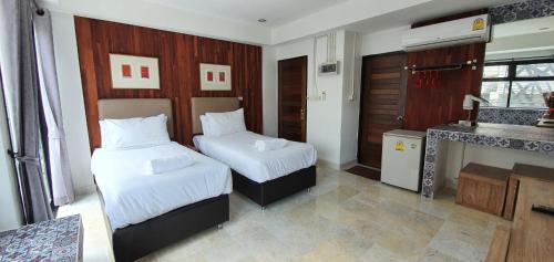 Ein Bett oder Betten in einem Zimmer der Unterkunft Janice Boutique House