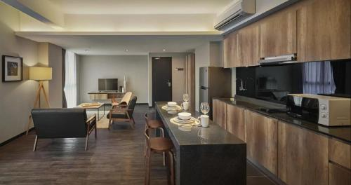 A kitchen or kitchenette at Tropics Eight Suites