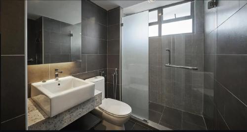 A bathroom at Tropics Eight Suites