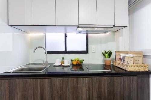 A kitchen or kitchenette at La Regatta Boutique Residences