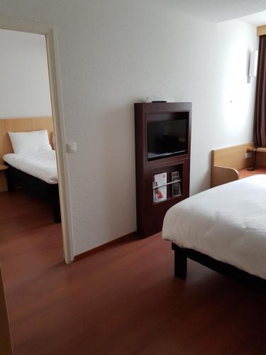 Un ou plusieurs lits dans un hébergement de l'établissement ibis Bayeux Port En Bessin