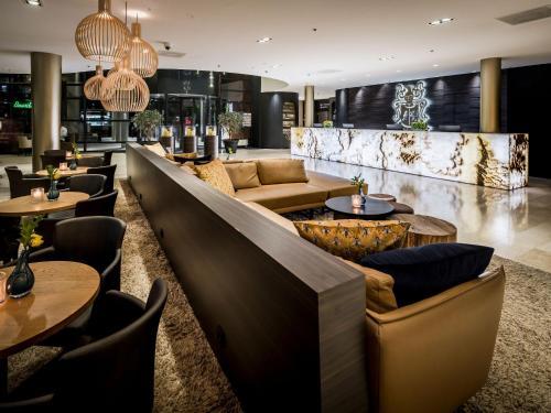 The lounge or bar area at Hotel Van der Valk Maastricht