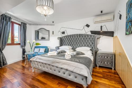 A bed or beds in a room at Galeria Valeria Seaside Downtown - MAG Quaint & Elegant Boutique Hotels