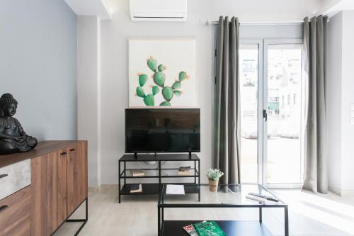 A television and/or entertainment centre at Omnia Pagrati Apartments