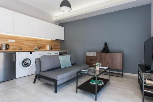 A kitchen or kitchenette at Omnia Pagrati Apartments