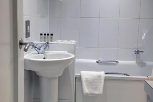 A bathroom at Corus Hyde Park Hotel