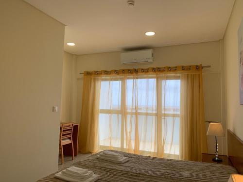 A bed or beds in a room at Solmar Alojamentos