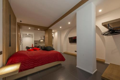 A bed or beds in a room at Il Rubino Holiday House
