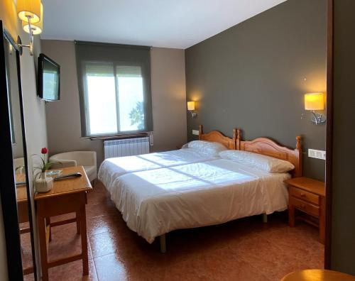 A bed or beds in a room at Hotel Casa Custodio