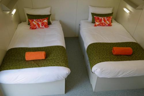 A bed or beds in a room at BIG4 St Helens Holiday Park
