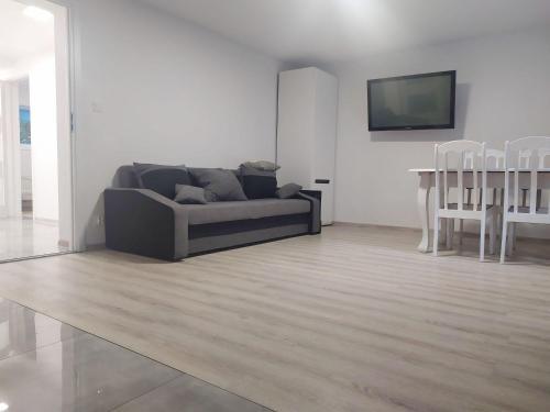 A seating area at Apartamenty Parkowa