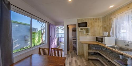 A kitchen or kitchenette at Two Shores Holiday Village