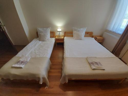 Ein Bett oder Betten in einem Zimmer der Unterkunft Przystanek Czapla