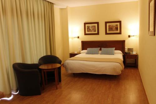 Säng eller sängar i ett rum på Gran Cervantes by Blue Sea