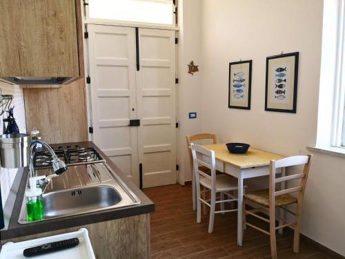 Cucina o angolo cottura di La Casa di Aurelio