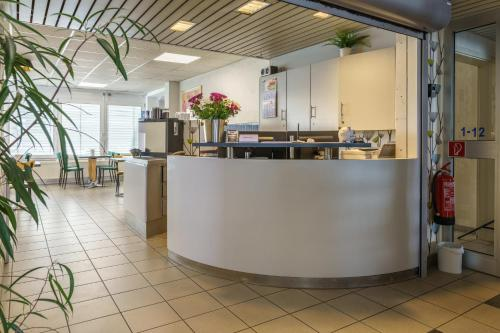 The lobby or reception area at Motel Drei König- Ihr Transithotel