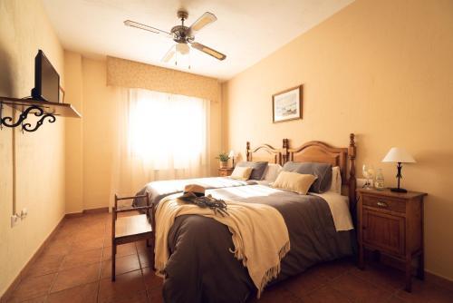 Cama o camas de una habitación en Hospedium Hostal Sierra del Agua