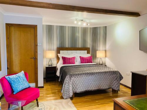 A bed or beds in a room at Millers House Boutique B&B