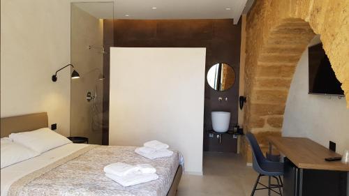 Letto o letti in una camera di Villa Lekythos