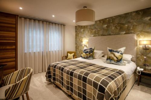 A bed or beds in a room at Briery Wood Hotel