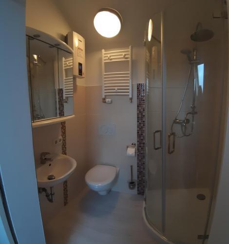 Ein Badezimmer in der Unterkunft ApartmentHotel Vollumen