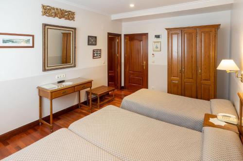 Cama o camas de una habitación en Hotel Leku Eder