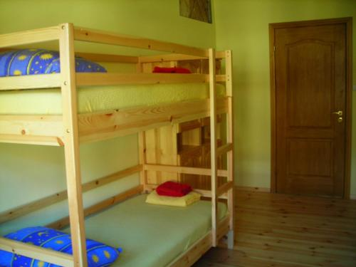 A bunk bed or bunk beds in a room at Hostel Mostel