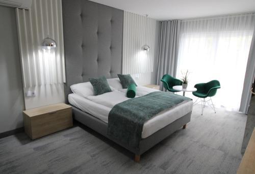 Łóżko lub łóżka w pokoju w obiekcie Grand Laola Spa