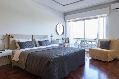 A bed or beds in a room at República Bed & Breakfast