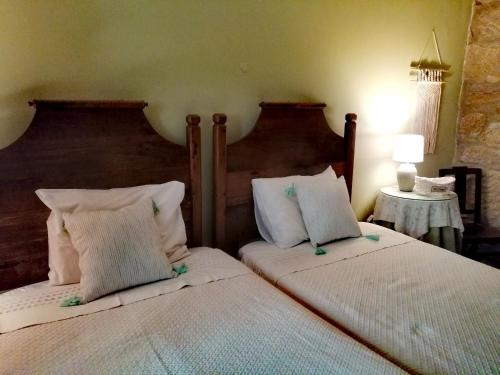 A bed or beds in a room at Quinta da Mata - Turismo de Habitação