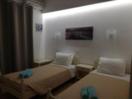 Ένα ή περισσότερα κρεβάτια σε δωμάτιο στο Πανσιόν Γαλήνη