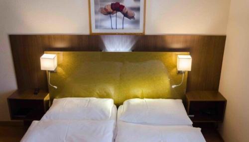 Кровать или кровати в номере Zys Hotel