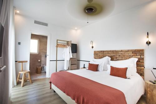 A bed or beds in a room at Mikasa Ibiza Boutique Hotel ADULTS ONLY