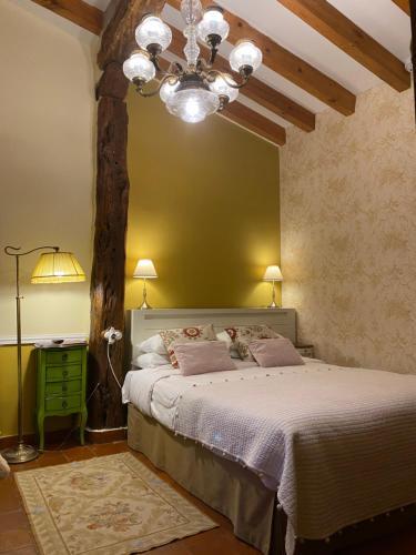 Cama o camas de una habitación en El Corral De Perorrubio