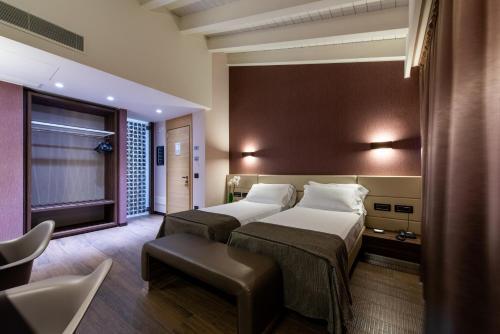 Letto o letti in una camera di Viola Mhotel