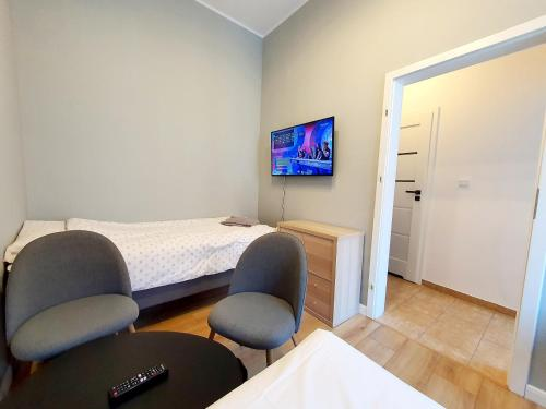 A bed or beds in a room at Apartament Kleopatra