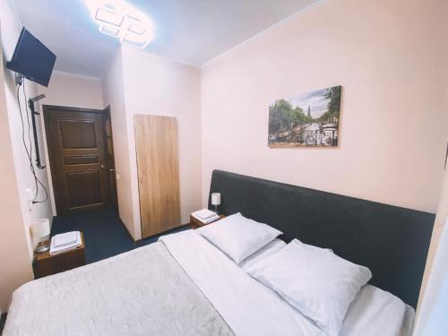 Кровать или кровати в номере Grechesky 13