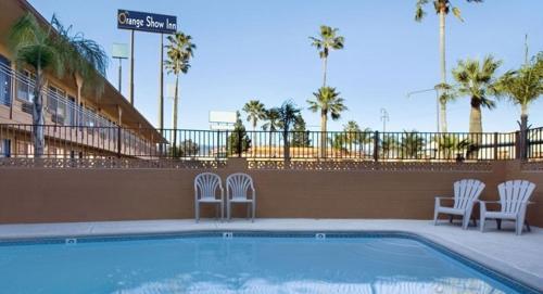 The swimming pool at or near Orange Show Inn