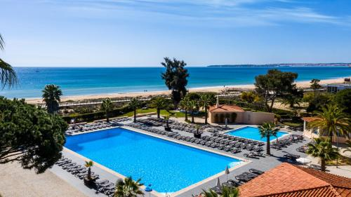 A view of the pool at Pestana D. João II Beach & Golf Resort or nearby