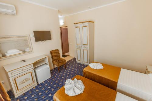 Кровать или кровати в номере Парк Отель Лермонтов