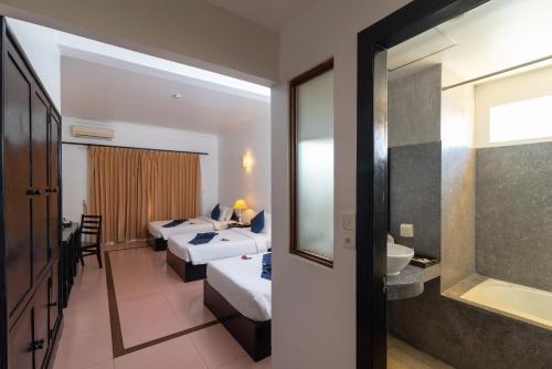 Un baño de Amber Angkor Villa Hotel & Spa