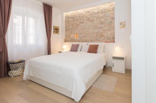 Posteľ alebo postele v izbe v ubytovaní Liberty Town Center Rooms