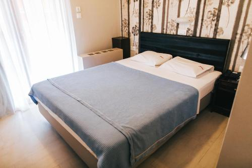 A bed or beds in a room at Fanari Hotel