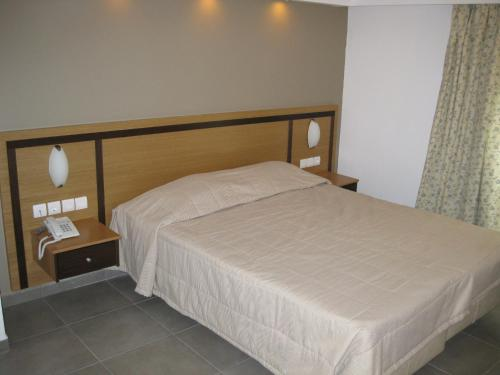 A bed or beds in a room at Mimosa Suites