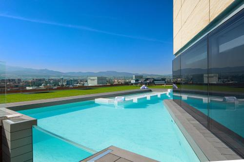 The swimming pool at or close to Barceló Granada Congress