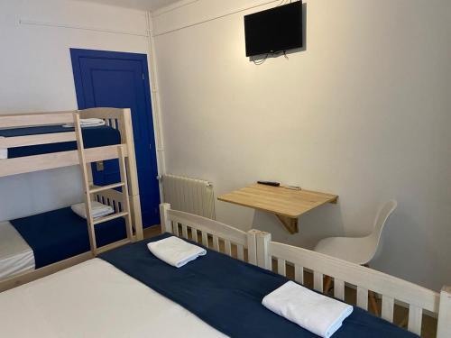 Litera o literas de una habitación en Hostal Portomar