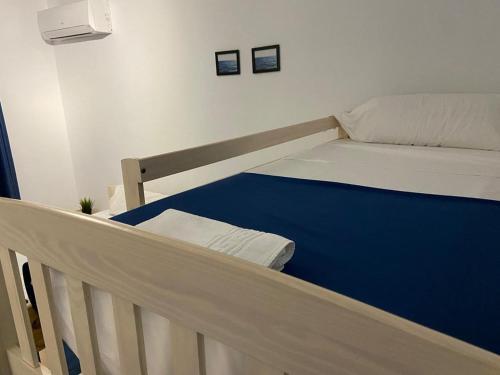 Cama o camas de una habitación en Hostal Portomar