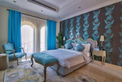 A bed or beds in a room at 7 Bedroom Beachfront Estate Sleeps 16