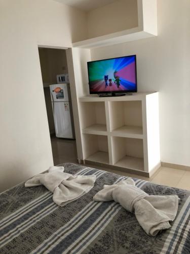 A bed or beds in a room at Departamentos Equipados Río Cuarto