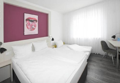 A bed or beds in a room at Hostel Art & Style